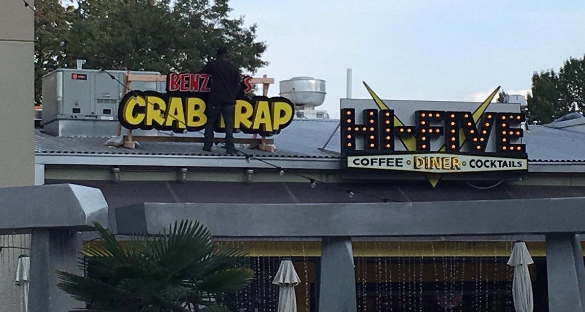 Crews put the temporary Benzino's signage in place. Photo via WNA reader Shannon J. Fain.