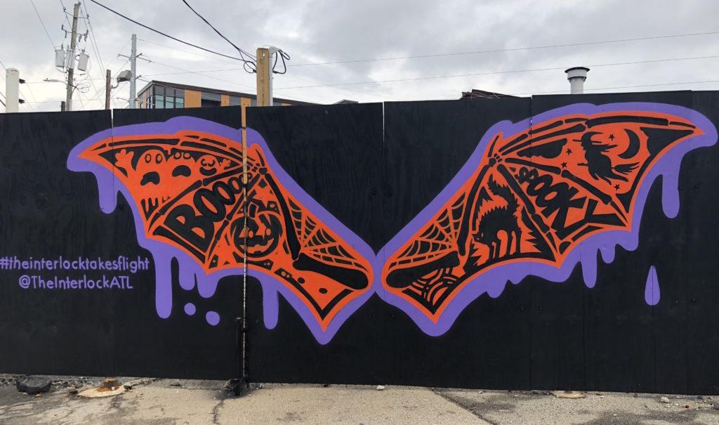 The mural of bat wings at The Interlock